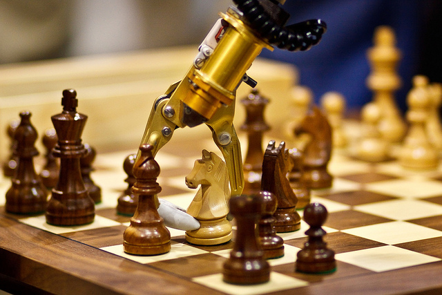 Robotic arm playing chess.